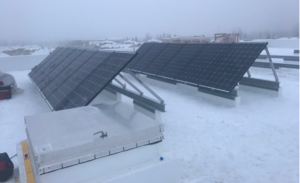 Solar panels on top of a building in the middle of winter. Done in Alaska by Vannoy Electric.